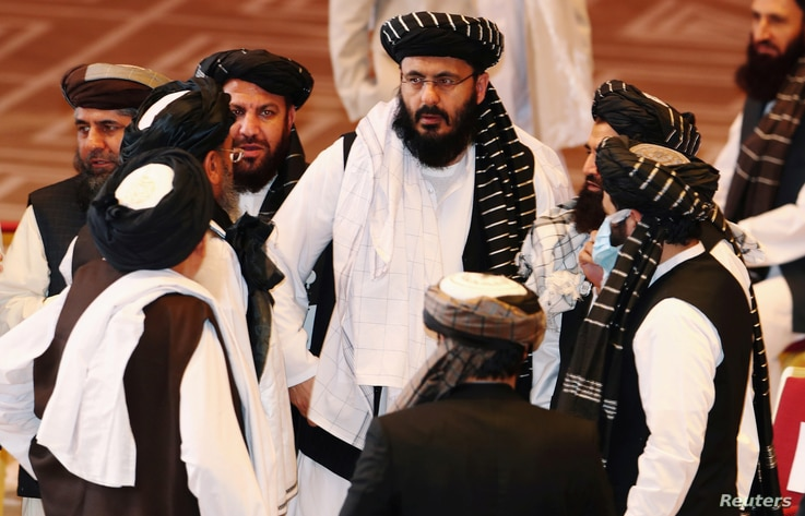 FILE PHOTO: Taliban delegates speak during talks between the Afghan government and Taliban insurgents in Doha, Qatar September...