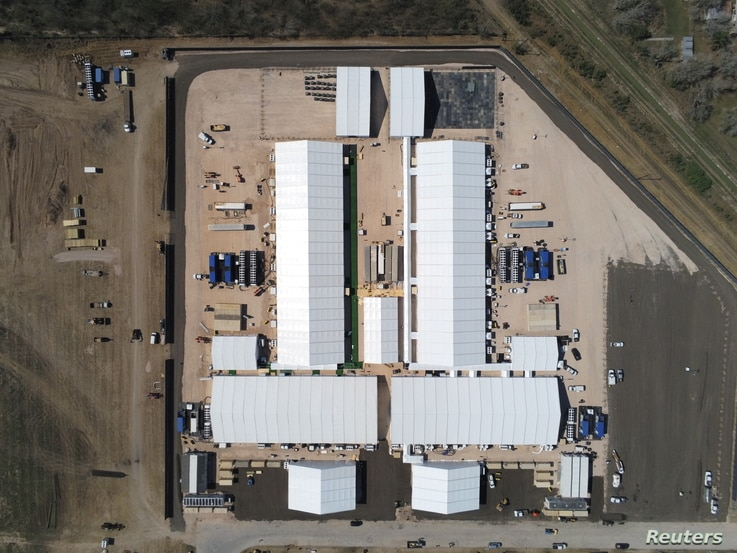 Soft sided structures, constructed in anticipation of a surge in migration at a U.S. Customs and Border Protection temporary…