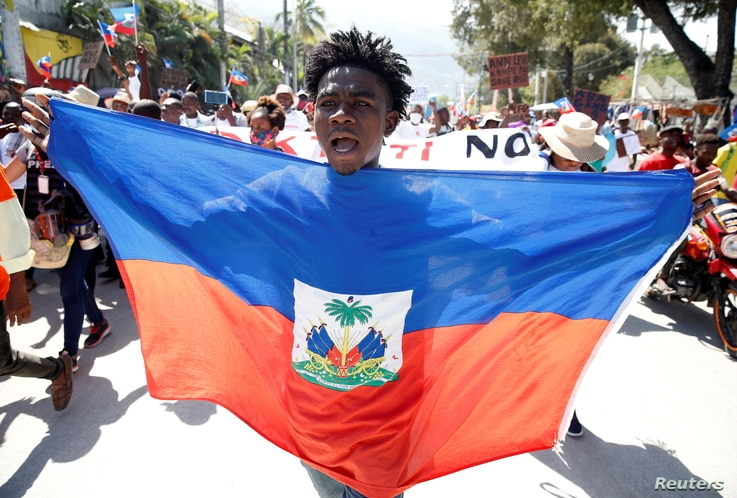 A demonstrator takes part in a march during a protest against Haiti's President Jovenel Moise, in Port-au-Prince, Haiti…