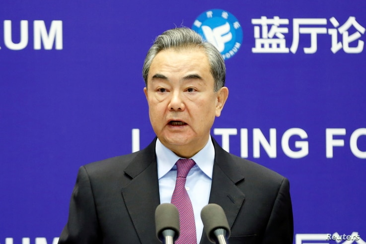 Chinese State Councilor and Foreign Minister Wang Yi delivers a speech at the Lanting Forum in Beijing, China February 22, 2021…