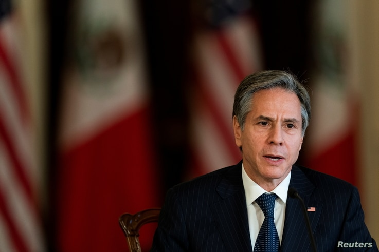 Secretary of State Antony Blinken, speaks in the Benjamin Franklin room at the State Department, during a virtual meeting with…