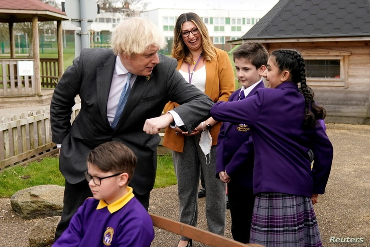 British Prime Minister Boris Johnson elbow bumps with the Head Girl during his visit to St Mary's CE Primary School, ahead of…