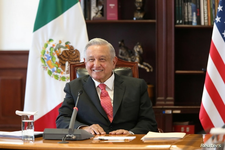 Mexico's President Manuel Lopez Obrador listens from the National Palace in Mexico City, Mexico, during a virtual bilateral...