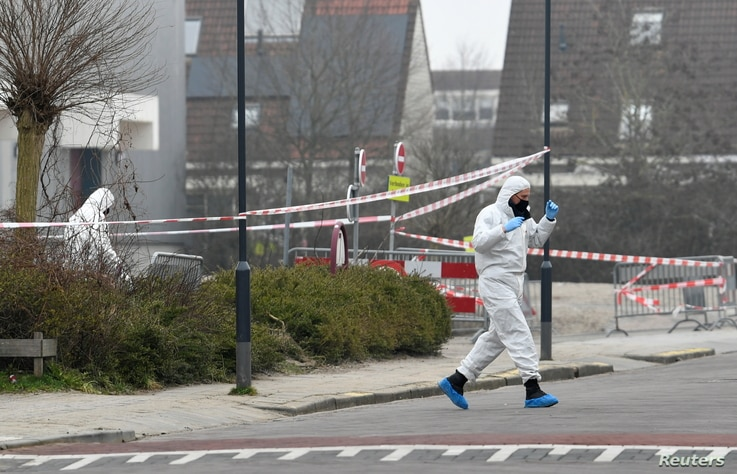 Forensic officers investigate the area at the scene of an explosion at a coronavirus disease (COVID-19) testing location in…
