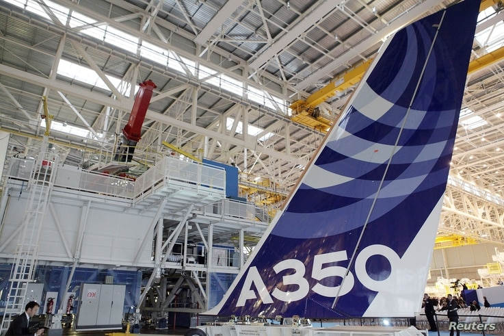 FILE PHOTO: The vertical tail wing of the first Airbus A350 is seen on the final assembly line in Toulouse, southwestern France…