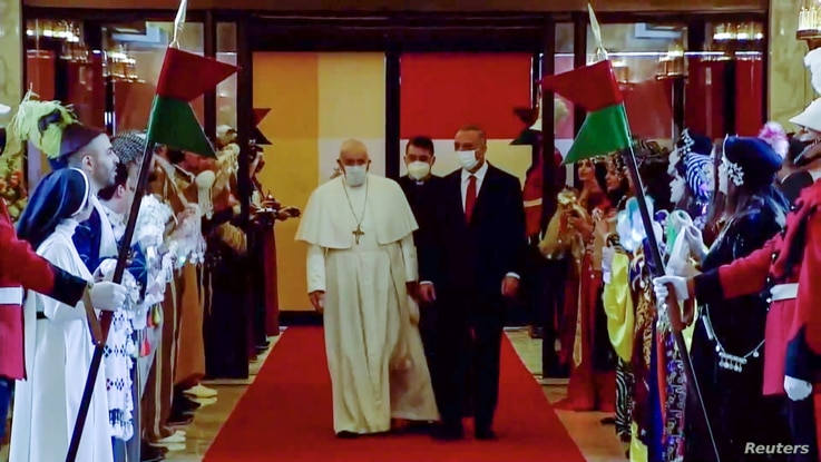 Pope Francis arrives at Baghdad International Airport where a welcoming ceremony is held to start his historic tour in Baghdad.