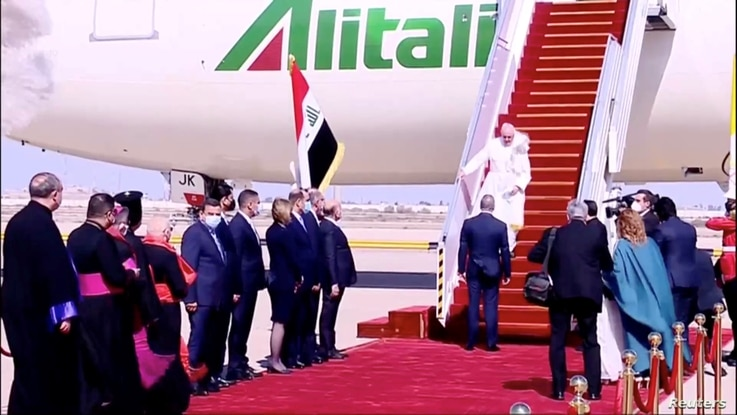 Iraqi Prime Minister Mustafa Al-Kadhimi welcomes Pope Francis as he arrives at Baghdad International Airport.