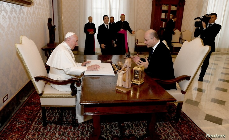 Iraq's President Barham Salih meets with Pope Francis during a ceremony, at the presidental palace in Baghdad, Iraq March 5.
