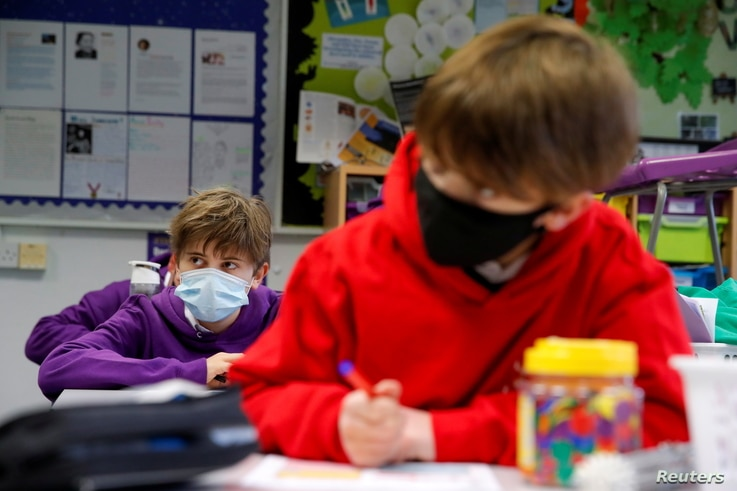 Students listen to a teacher during a lesson at Heath Mount school as schools reopen in England, amid the coronavirus disease ...