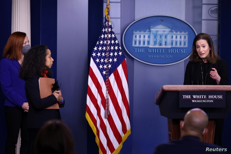 White House Press Secretary Jen Psaki and Chief of Staff to the First Lady Julissa Reynoso watch as Executive Director of the…