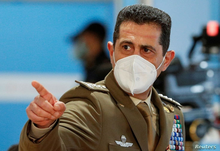 FILE PHOTO: Italy's special COVID-19 commissioner General Francesco Paolo Figliuolo gestures during a visit to a mass…