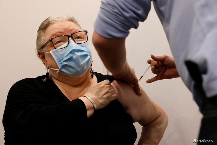 A pharmacist administers the AstraZeneca COVID-19 vaccine to a patient in a pharmacy in Roubaix as part of the coronavirus…