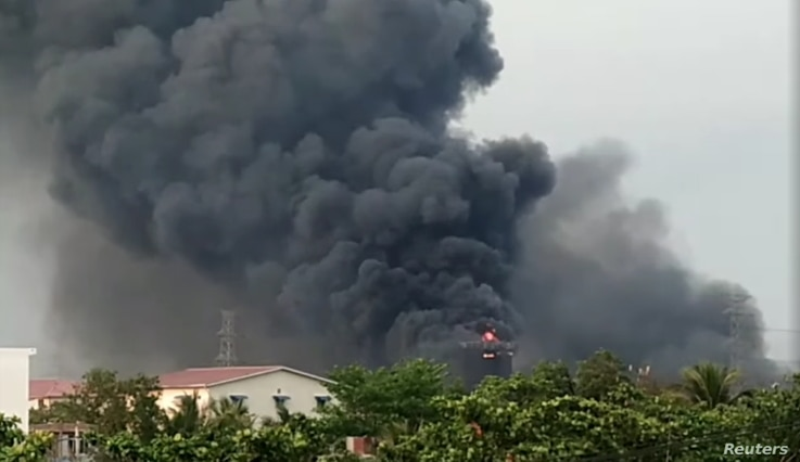 A view shows the fire at Hlaing Thar Yar factory, in Yangon, Myanmar, March 14, 2021, in this still image obtained by Reuters...
