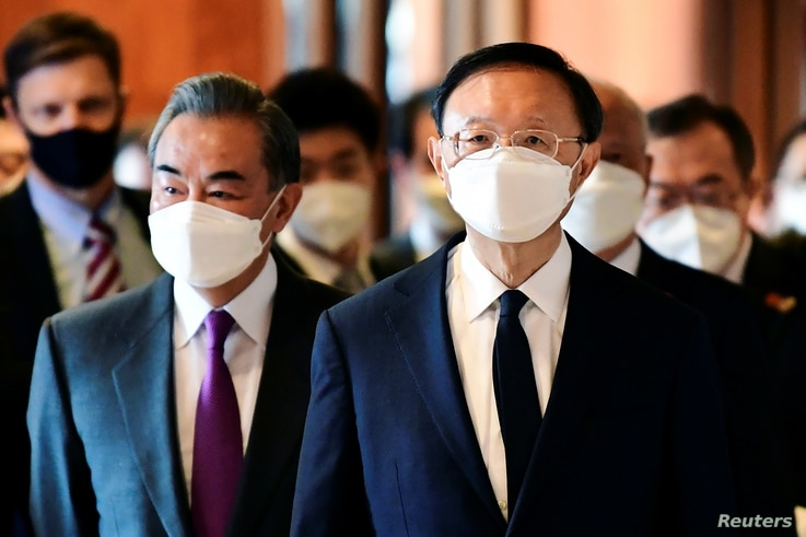 Yang Jiechi (R), director of the Central Foreign Affairs Commission Office for China, and Wang Yi (L), China's State Councilor…