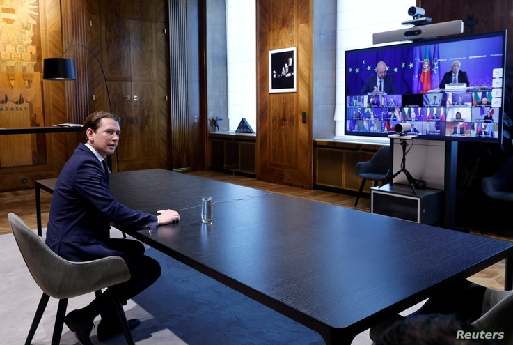 Austria's Chancellor Sebastian Kurz waits for the start of an EU summit held via video conference, in his office, as the spread…