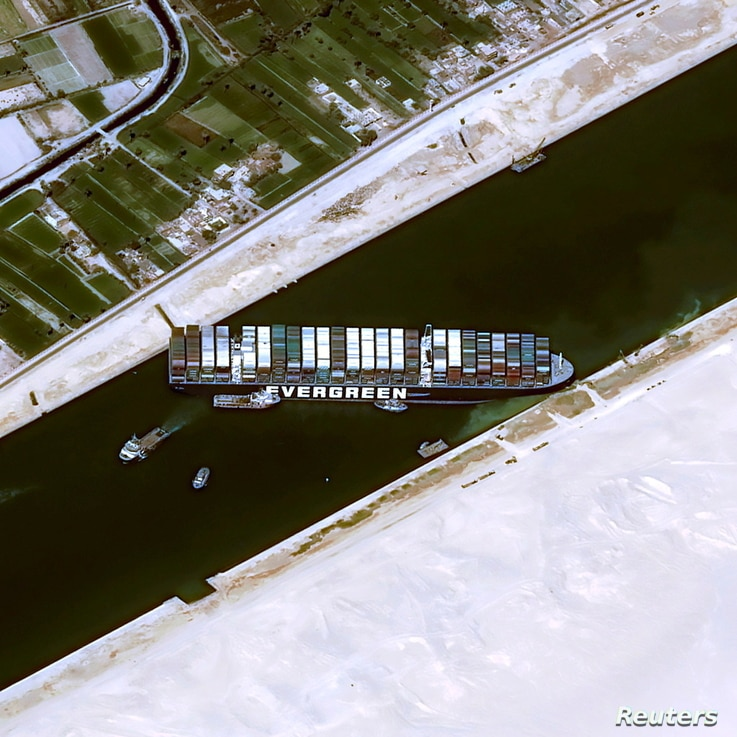 A satellite image shows stranded container ship Ever Given after it ran aground in Suez Canal, Egypt March 25, 2021. CNES…