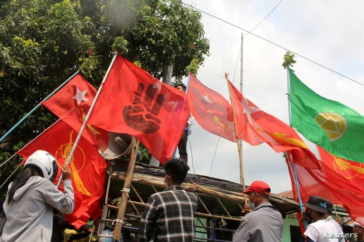 Demonstrators display flags during a protest in Launglone, Dawei district, Myanmar on March 26, 2021. (Dawei Watch/Reuters)