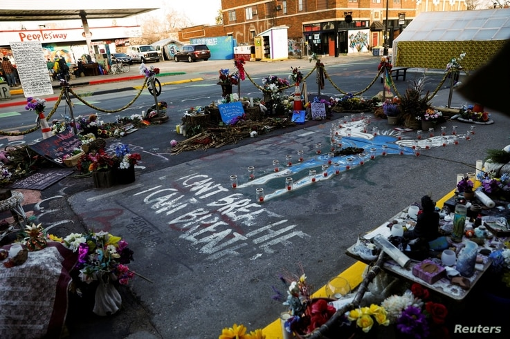 A memorial at the place where George Floyd died is seen in front of Cup Foods at George Floyd Square while the city of…