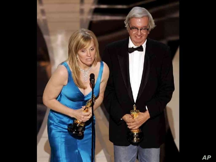 """Diana Ossana and Larry McMurtry, writers, accept the Oscar for best adapted screenplay for their work on """"Brokeback Mountain"""" at the 78th Academy Awards, Los Angeles, California, photo on black   Photo Details ID:060305061297 Submission Date:Apr 11, 2009 6:35PM (GMT 23:35) Creation Date:Mar 05, 2006 12:00AM (GMT 00:00)"""