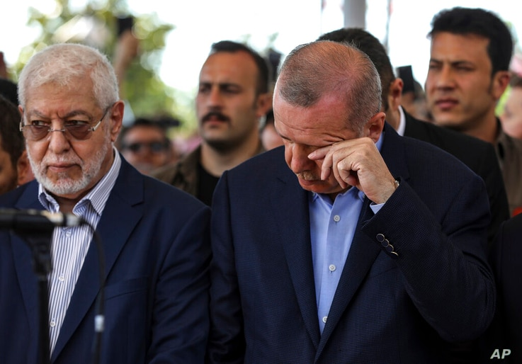 Turkish President Recep Tayyip Erdogan reacts as he he attends funeral prayers in absentia for ousted former Egyptian President…