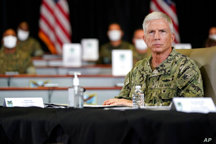 U.S. Navy Adm. Craig Faller listens during a briefing on counternarcotics operations at U.S. Southern Command, Friday, July 10,…