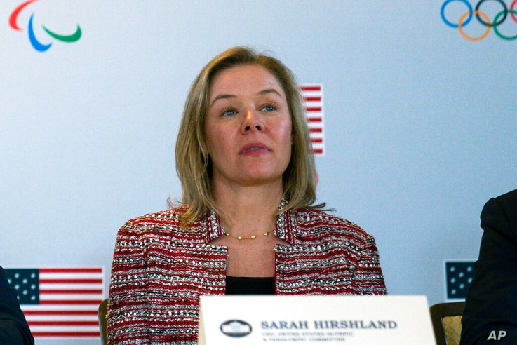 FILE - In this Feb. 18, 2020, file photo, United States Olympic and Paralympic Committee CEO Sarah Hirshland listens as…