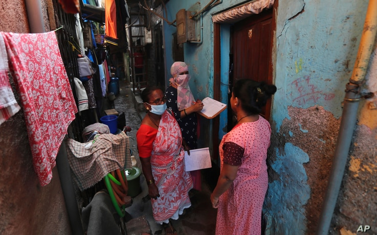 Health workers screen people for tuberculosis and leprosy in Dharavi, one of Asia's biggest slums, in Mumbai, India, Tuesday,...