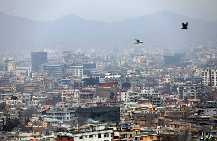 Birds flyover the city of Kabul, Afghanistan, Sunday, Jan. 31, 2021.  In a report released Monday, Feb. 1, 2021, the Special…