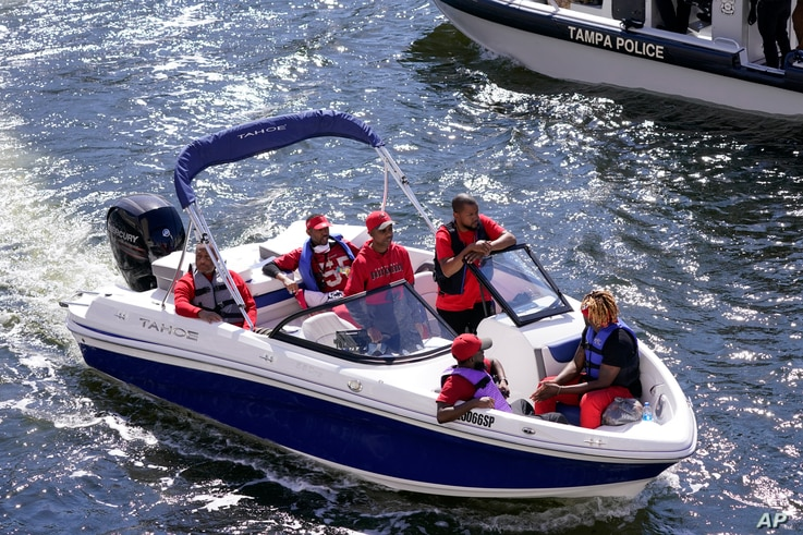 FILE - In this Feb. 5, 2021, file photo, Tampa Bay Buccaneers fans travel by boat along the Hillsborough River in Tampa, Fla…