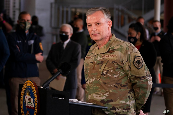 U.S. Air Force Gen. Glen D. VanHerck speaks during a news conference at a joint state and federal mass vaccination site set up…