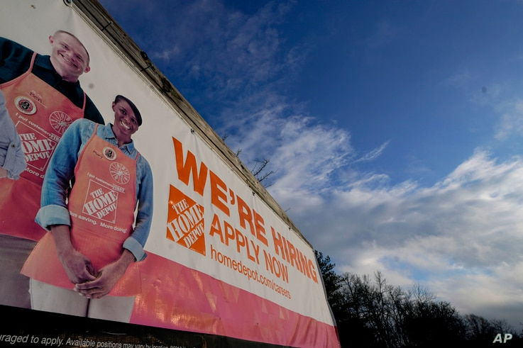A sign announcing hiring is displayed in the parking lot of a Home Depot, Monday, Feb. 22, 2021, in Cockeysville, Md. The…