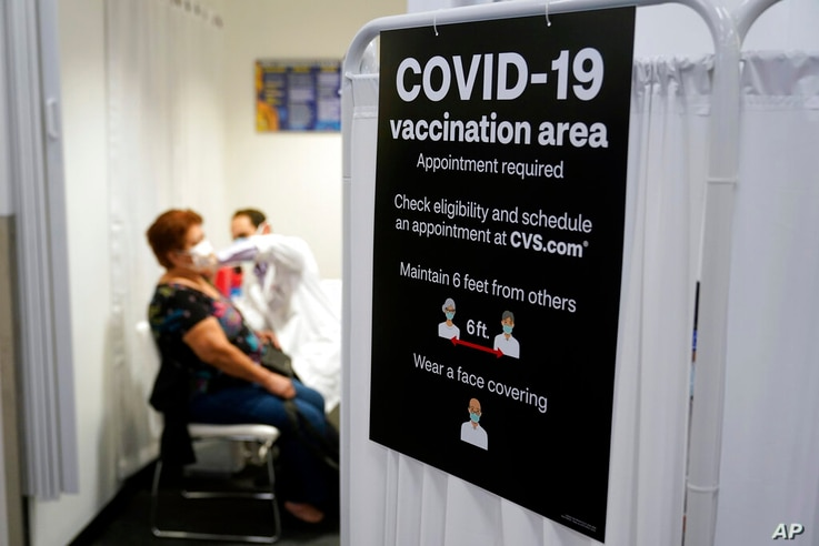 A patient receives a shot of the Moderna COVID-19 vaccine at a CVS Pharmacy branch Monday, March 1, 2021, in Los Angeles. (AP…