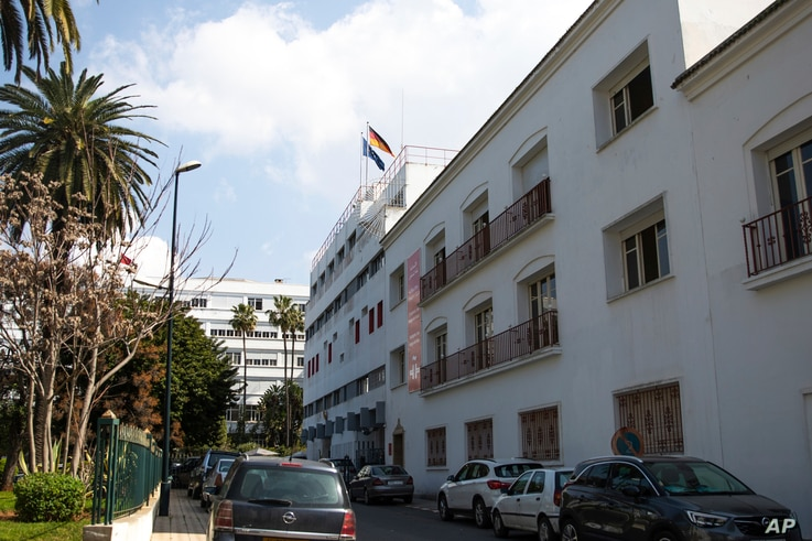 """The German and EU flags on the German embassy building in Rabat, Morocco, March 2, 2021. Morocco's Foreign Ministry has suspended ties with the German Embassy because of unspecified """"deep misunderstandings."""""""