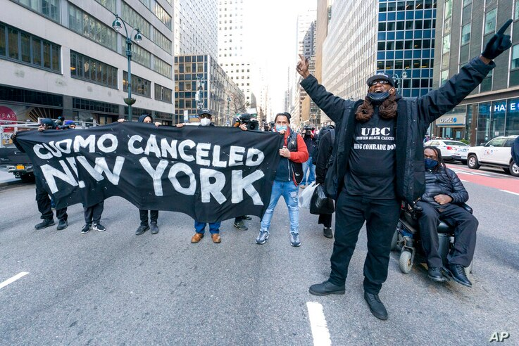 Activist with VOCAL-NY block traffic on 3rd Ave. outside New York Gov. Andrew Cuomo's office, Wednesday, March 10, 2021, in New…
