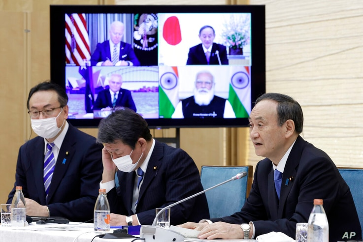 Japan's Prime Minister Yoshihide Suga speaks during the virtual summit of the leaders of Australia, India, Japan and the U.S.,...