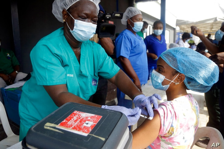 Hospital staff receives one of the country's first coronavirus vaccinations using AstraZeneca COVID-19 vaccine manufactured by...