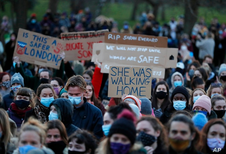 People gather, at the band stand in Clapham Common, in memory of Sarah Everard, after an official vigil was  cancelled, in…