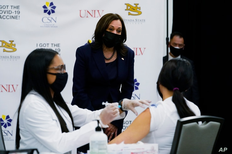 Vice President Kamala Harris looks over a vaccination site at the University of Nevada in Las Vegas, Monday, March 15, 2021…