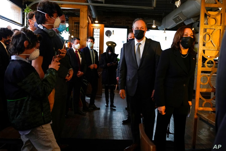 Vice President Kamala Harris and her husband Doug Emhoff arrive at Maria Empanada, Tuesday March 16, 2021, in Denver. (AP Photo…