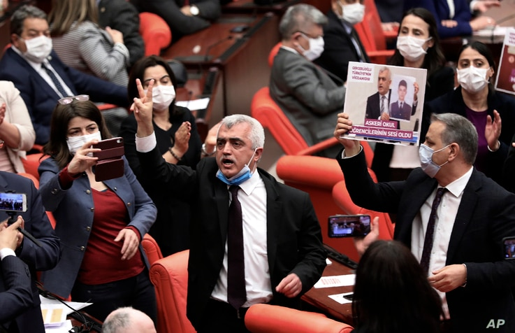 Omer Faruk Gergerlioglu, a human rights advocate and lawmaker from the People's Democratic Party, or HDP, center, reacts after…