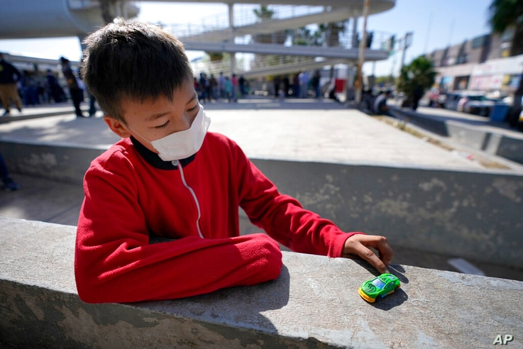 Dany Vargas Rodriguez, 10, a migrant from Honduras, plays with a car he was gifted at a plaza near the McAllen-Hidalgo…