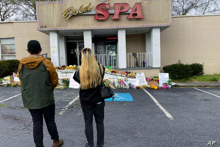 People view a makeshift memorial on Friday, March 19, 2021, in Atlanta.  Robert Aaron Long, a white man, is accused of killing…