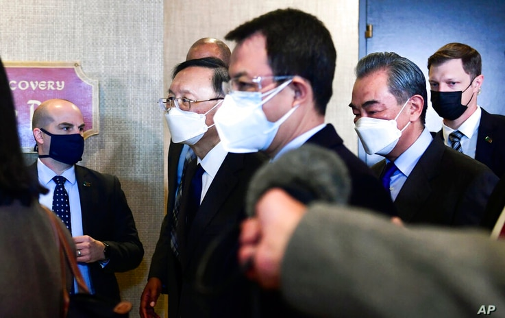 Chinese Communist Party foreign affairs chief Yang Jiechi, second from left, and China's State Councilor Wang Yi, second from…
