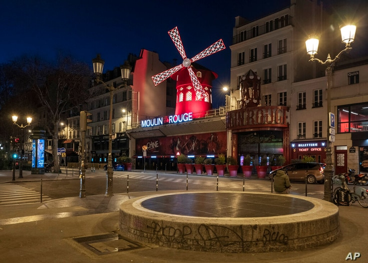 Empty streets in front of the Moulin Rougeas the 7 p.m curfew starts in Paris, France, on Saturday, March 20, 2021. The French…