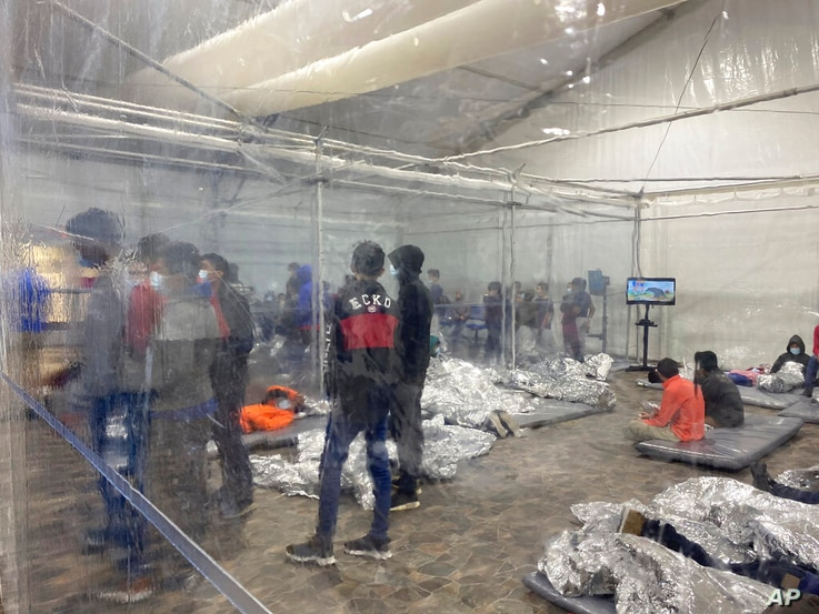 This March 20, 2021 photo provided by the Office of Congressman Henry Cuellar, (TX-28), shows detainees in a Customs and Border…