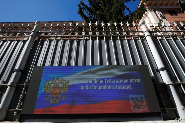 The Russian Embassy in Rome, Wednesday, March 31, 2021. Italy has ordered two Russian Embassy officials expelled and arrested…