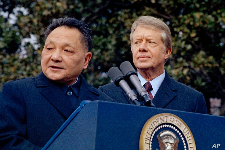 FILE - In this Jan. 29, 1979 file photo, then U.S. President Jimmy Carter, right, and then Chinese Vice Premier Deng Xiaoping…