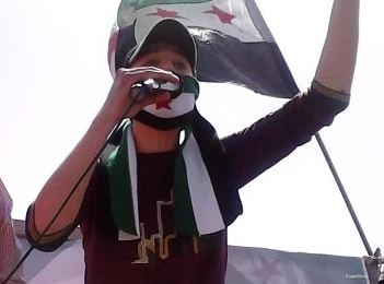 Syrian refugee Anas Allouz speaks during a protest outside the Syrian Embassy in Jordan in 2012. (Submitted photo)