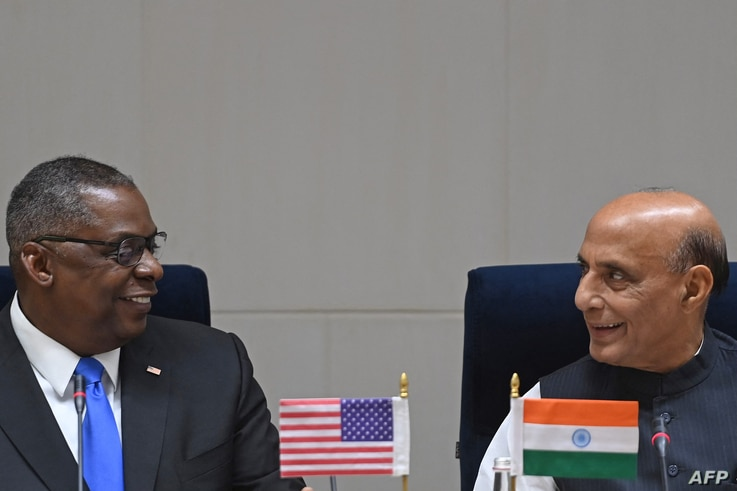 Visiting U.S. Defense Secretary Lloyd Austin (L) interacts with Indian Defense Minister Rajnath Singh during a joint media briefing in New Delhi, March 20, 2021.