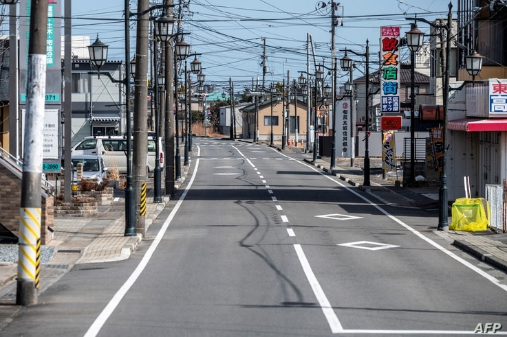 A picture taken on March 1, 2021, shows the main street of Namie, Fukushima Prefecture. The town was part of an exclusion zone around the Fukushima Daiichi nuclear plant since the 2011 accident but has since partially reopened.